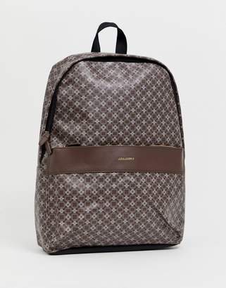 631464bb2c1 Asos Design DESIGN faux leather backpack in brown geo print