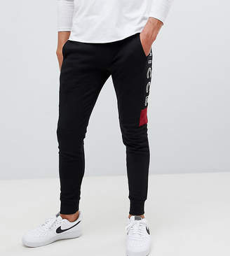 Nicce London skinny joggers in black with side logo exclusive to ASOS