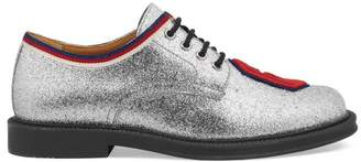 Gucci Children's glitter lace-up with patch