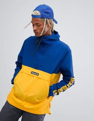 Timberland overhead windbreaker jacket with hood in navy and yellow