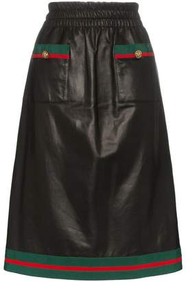 Gucci two pocket web trimmed leather skirt