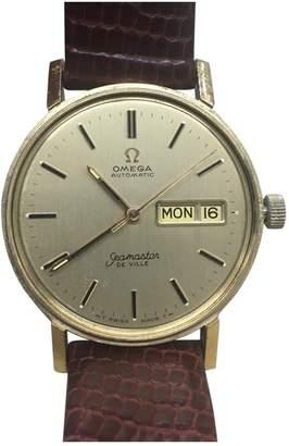 Omega Seamaster yellow gold watch