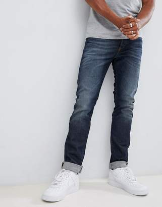 Diesel Buster regular slim fit jeans in 084ZU mid wash