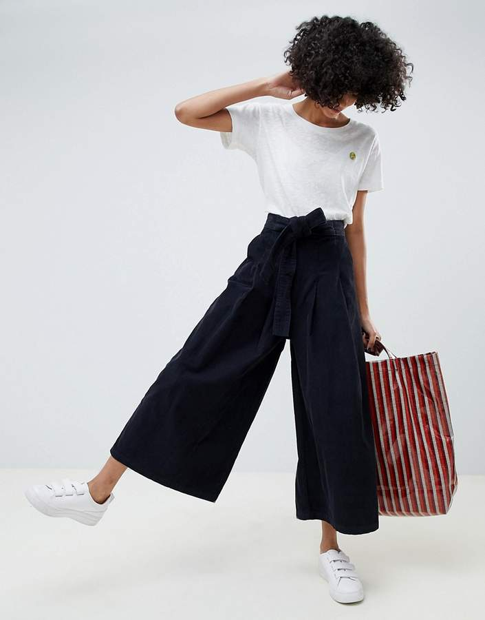 ASOS DESIGN wide leg in navy cord jeans with waist tie
