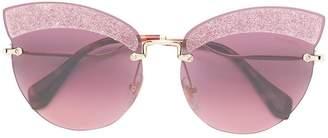 Miu Miu Runaway show glitter sunglasses