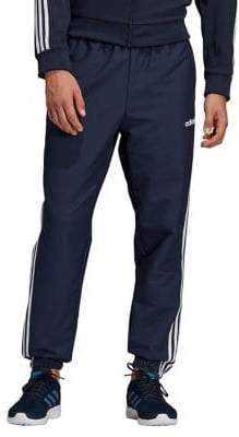 cc649645e053f adidas Essentials 3-Stripes Wind Pants