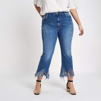 River Island Plus mid blue fringed hem cropped flare jeans