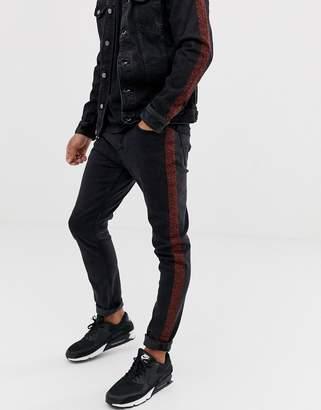 Pull&Bear slim fit jeans with leopard print side stripe in black
