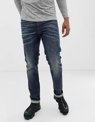 20a666eb Diesel Buster regular slim fit jeans in 084ZU mid wash