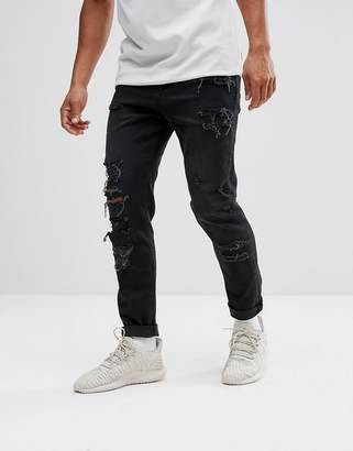 Asos DESIGN tapered jeans in 12.5oz in washed black with heavy rips