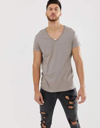 55407525642c BEIGE Asos Design ASOS DESIGN t-shirt with deep v neck and roll sleeve in