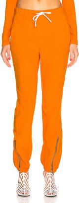 Cotton Citizen Milan Zip Jogger in Tangerine | FWRD