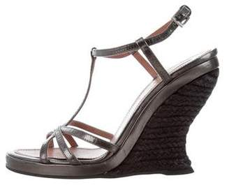 Alaia Metallic Wedge Sandals