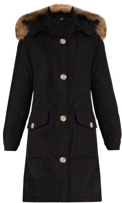 WOOLRICH JOHN RICH & BROS. Arctic fur-trimmed cotton-blend canvas parka $850 thestylecure.com