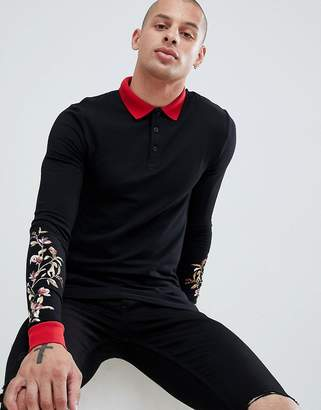 Asos DESIGN muscle fit long sleeve polo shirt with floral sleeve and contrast collar