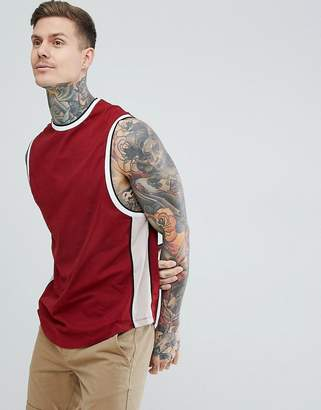 Asos DESIGN longline sleeveless t-shirt with curve hem with contrast side panel in red