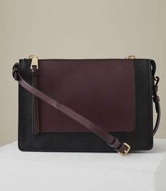 At Reiss Dalston Leather Cross Body Bag In Berry Black