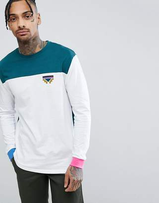 Asos DESIGN relaxed long sleeve t-shirt with color block detail and geo-tribal chest print