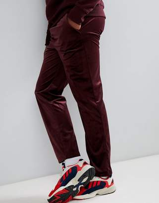 Asos DESIGN slouch fit pants in burgundy velour