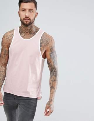 Asos DESIGN longline skater tank with contrast bound hem in pink