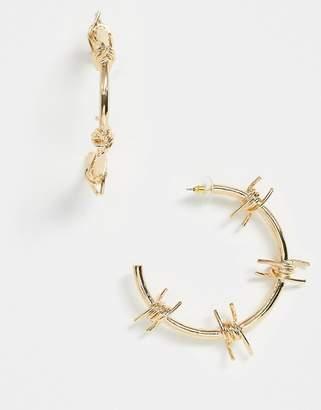 Asos Design DESIGN hoop earrings in barbed wire design in gold tone