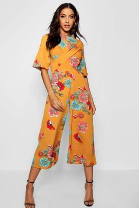 f650150330fa boohoo Large Floral Twist Front Jumpsuit