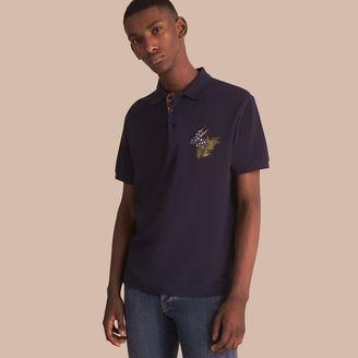 Burberry Beasts Motif Cotton Piqué Polo Shirt $275 thestylecure.com
