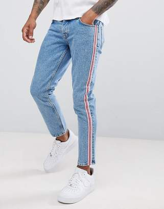 Asos Design DESIGN slim jeans in mid wash blue with pink side stripe