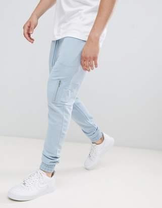 Asos Design DESIGN skinny joggers with MA1 pocket in light blue