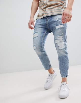 Stradivarius Carrot Fit Jeans With Zips and Abrasion In Light Blue