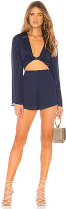 About Us Claudia Twist Long Sleeve Romper
