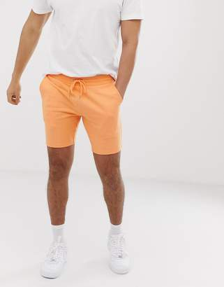 Asos Design DESIGN jersey skinny shorts in orange