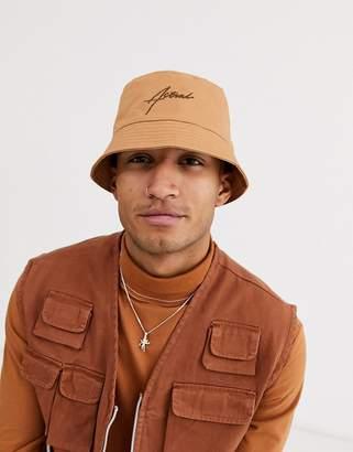 Asos Design DESIGN bucket hat in camel with dark brown embroidery