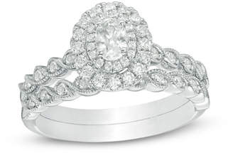 Zales 3/4 CT. T.W. Oval Diamond Double Frame Twist Vintage-Style Bridal Set in 14K White Gold