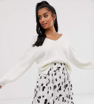 Asos DESIGN Petite fluffy v neck ribbed jumper with balloon sleeve in recycled blend
