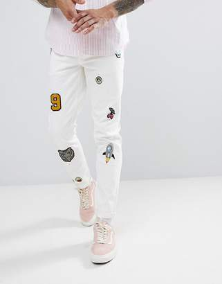 Asos DESIGN Skinny Jeans In White With Patches