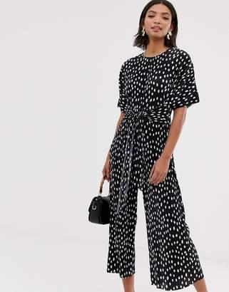 947ec11d4ef Asos Design DESIGN plisse tie front jumpsuit in spot print