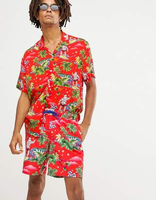 Asos DESIGN Holidays swim shorts with surfing santa print in mid length