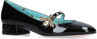 Gucci Patent Lois Bee Pumps 25