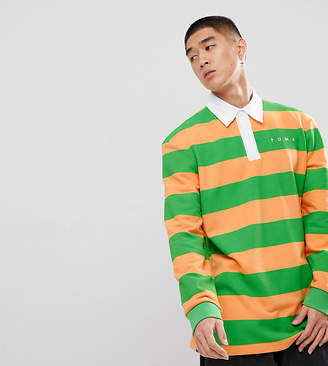 Puma striped rugby shirt in orange Exclusive at ASOS