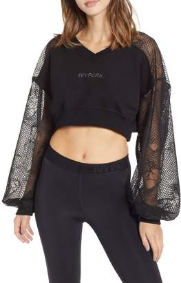 Ivy Park R) Distressed Mesh Sleeve Crop Top