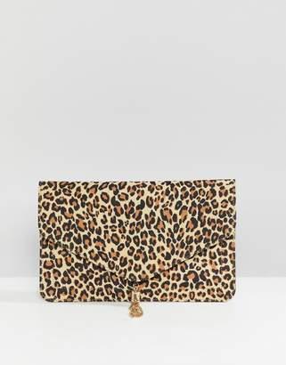 Asos DESIGN tassel clutch bag in leopard