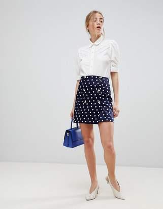 Asos DESIGN double breasted mini skirt in spot