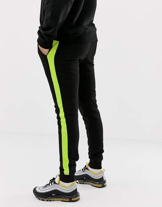 Asos DESIGN super skinny joggers with side stripe in neon green