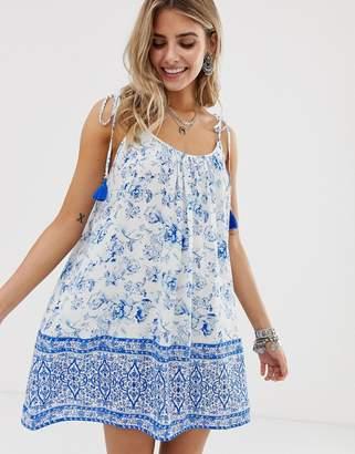 En Creme En CrMe border print cami dress with tassle detail