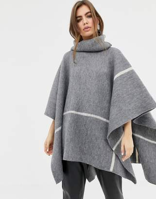 B.young roll neck poncho