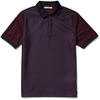 Burberry London Panelled Jacquard and Cotton-Piqué Polo Shirt $450 thestylecure.com