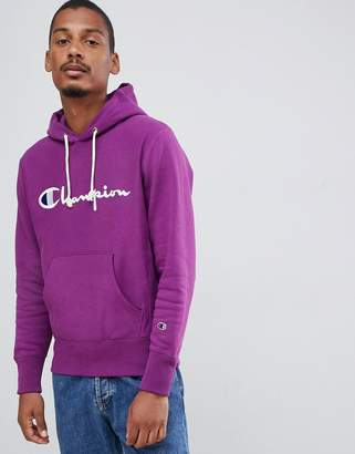 Champion reverse weave hoodie with large script logo in purple