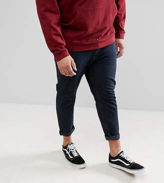 Asos DESIGN Plus Tapered Jeans In Overdyed Wash With Rips