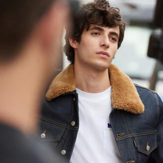 Sandro Raw denim jacket with a sheepskin collar